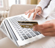 Woman's holding a credit card and using laptop, online shopping